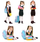 Cute little girl in school uniform isolated on white — Stock Photo