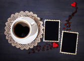 Composition with coffee cup, decorative hearts and old blank photos, on wooden background — Stock Photo