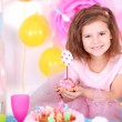 Pretty little girl celebrate her birthday — Stock Photo #42953613