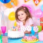 Pretty little girl celebrate her birthday — Stock Photo #42954369