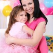 Pretty little girl with mom celebrate her birthday — Stock Photo #42957109