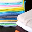 Stack of colorful clothes, on dark background — Stock Photo #42957161