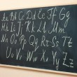 The alphabet written on the blackboard — Stock Photo #42958277