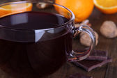 Mulled wine with orange and spices on table close up — Stock Photo