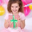 Pretty little girl with gift celebrate her birthday — Stock Photo