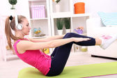 Young beautiful fitness girl exercising  at home — Foto de Stock