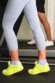 Women and men feet on treadmill close-up — Stock Photo