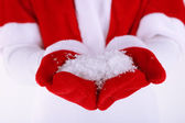 Girl in Christmas red cape and gloves, on winter background — Stock Photo