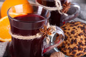 Mulled wine with oranges and cookies on table close up — Stock Photo