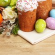 Beautiful Easter cakes, colorful eggs and candles on wooden table — Stock Photo #42984901