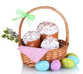 Beautiful Easter cakes in basket, colorful eggs and pussy-willow twigs isolated on white — Stock Photo