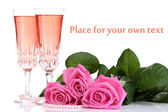 Composition with pink sparkle wine in glasses and pink roses isolated on white — ストック写真