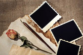 Composition with blank old photos, paper, letters on sackcloth background — Stock Photo