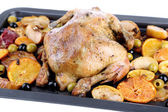 Whole roasted chicken with vegetables on tray, isolated on white — Stock Photo