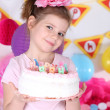Pretty little girl with cake celebrate her birthday — Stock Photo #42991169