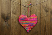 Decorative heart on wooden background — Стоковое фото