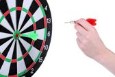 Dart board and hand with dart isolated on white — Stock Photo