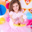 Pretty little girl with cakes celebrate her birthday — Stock Photo