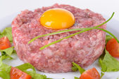 Delicious steak tartare with yolk on plate close-up — Stock Photo