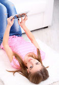 Young woman resting with  tablet at home — Stock Photo