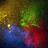 Colorful powders,  on black background — Stock Photo