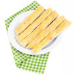 Tasty bread sticks on plate isolated on white — Stock Photo #43072993