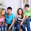 Group of young friends playing video games at home — Stock Photo #43074715
