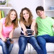Group of young friends playing video games at home — Stock Photo #43074721