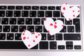 Bright hearts on computer keyboard close up — Stock Photo