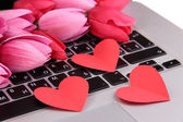 Red hearts and flowers on computer keyboard close up — Stock Photo