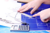 Architectural project with female hands, close up — Stock Photo