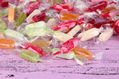 Tasty candies on wooden background — Stock Photo