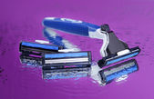 Men shaver on purple background — Stock Photo