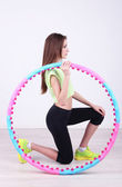 Woman doing exercises with hula hoop in room — Foto de Stock