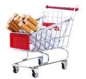 Cigarettes in shopping cart isolated on white — Stock Photo