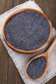 Poppy seeds on table close-up — Stock Photo