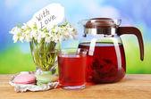 Tasty herbal tea and cookies on table — Stock Photo