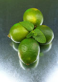Fresh limes on bright background — Zdjęcie stockowe