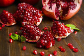 Ripe pomegranates on table close-up — 图库照片