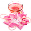 Composition with pink sparkle wine in glass and rose petals isolated on white — Stock Photo