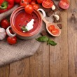 Tasty tomato soup and vegetables on wooden table — Stock Photo #43136651