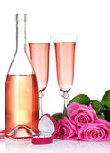 Composition with pink sparkle wine in glasses, bottle and pink roses isolated on white — Стоковое фото