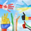 Flag of different countries painted on hand — Stock Photo #43170935