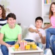Group of young friends watching television at home — Stock Photo #43171987