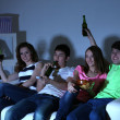 Group of young friends watching television at home of blacking-out — Stock Photo #43172017