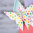 Origami butterfly and color papers on wooden table — Stock Photo