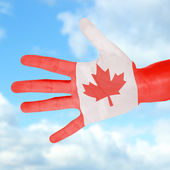 Flag of Canada painted on hand — Stock Photo