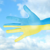 Flag of Ukraine painted on hand — Стоковое фото