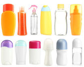 Collage of cosmetic bottles isolated on white — Stockfoto