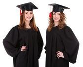 Dva šťastné absolvování studenti izolovaných na bílém — Stock fotografie